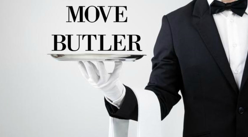 Butler holding silver plate
