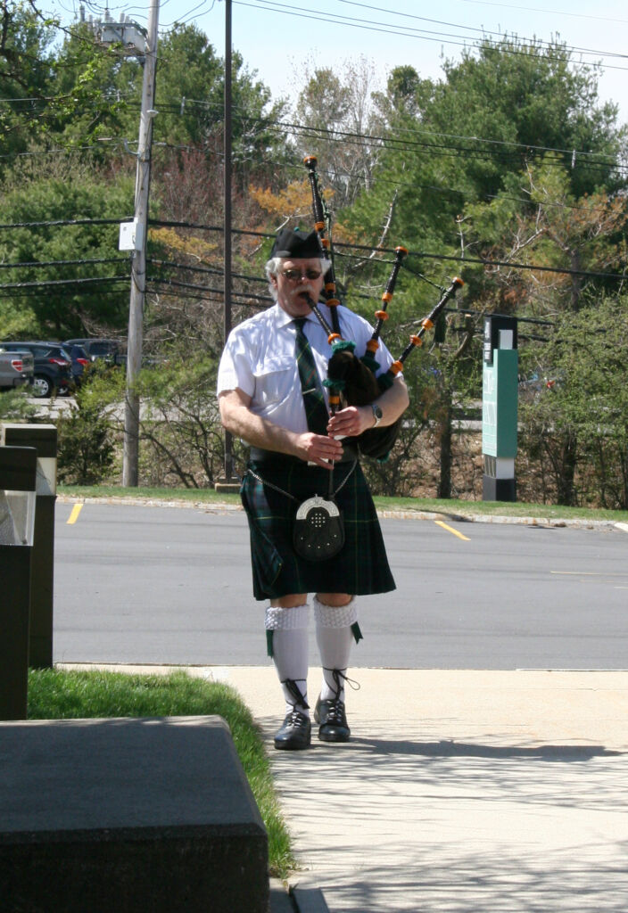 Playing a bag pipe