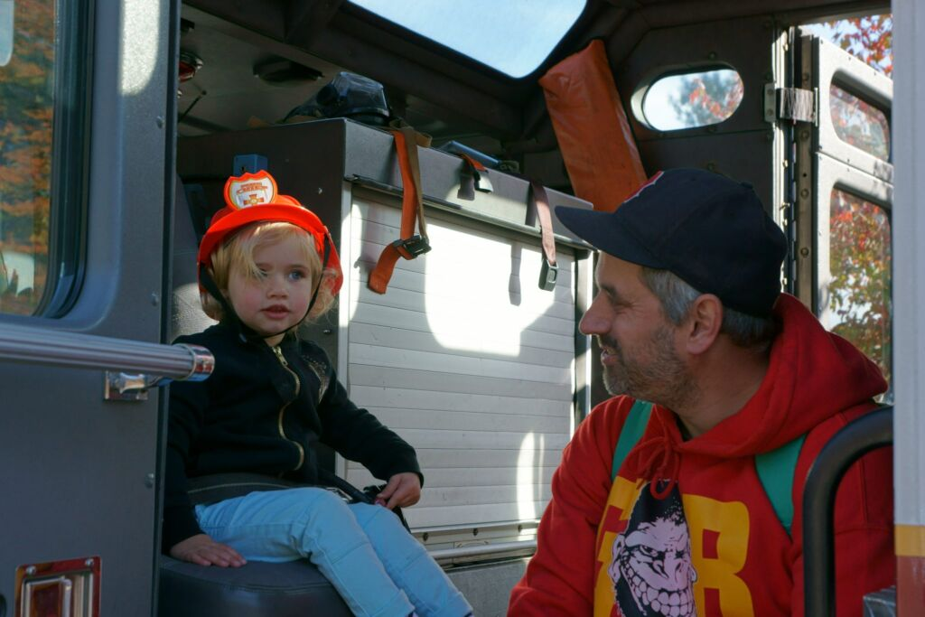 Man and child sitting in moving truck