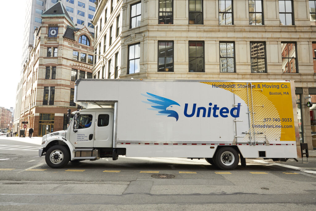 Moving truck in front of building