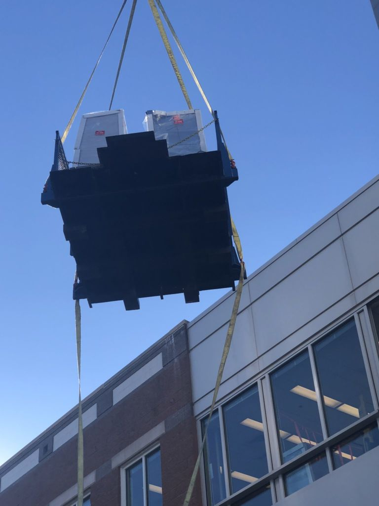 Lab equipment being moved by a crane