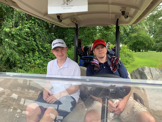 Sitting in golf cart